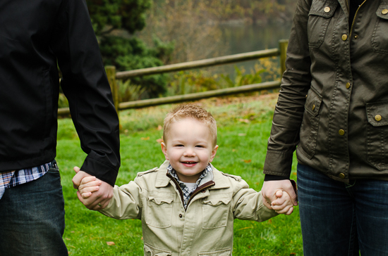 photo of toddler holding parents hands