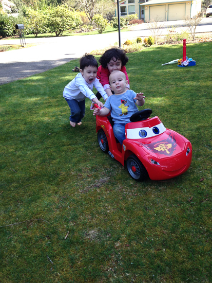 photo of kids with toy car